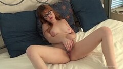 Cute redhead in glasses orgasms in her first video Thumb