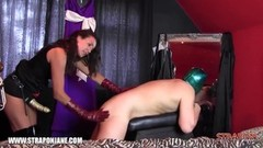 Strapon Jane dominates slave leather gloves ass fuck Thumb