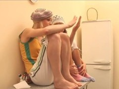 duo lesbians on the table undressing Thumb