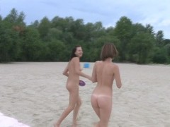 Young nudist friends naked together at the beachclick to edit Thumb