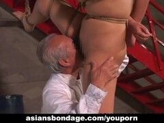 Kinky Asian babe in bondage receives a nasty dildo Thumb