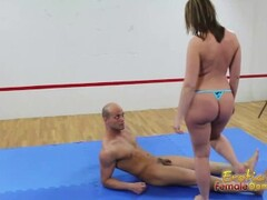 Brunette on mat controls her submissive man Thumb