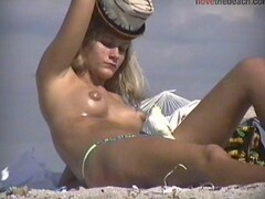 Blonde with puffy nipples topless on the beach Thumb