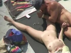 Naked wife plays with husband's cock on the beach Thumb
