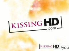 Kissing HD Cute young girls kiss and cuddle on the couch Thumb