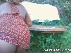 African girl flashing outdoors Thumb