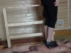 Black heels boots cruel trampling and stinging the heels into the body Thumb
