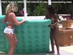 Blonde and Ebony Lesbian Catfight Sex in The Pool Thumb