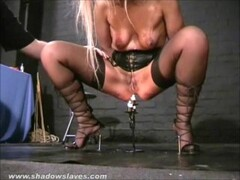 Submissive Crystel Leis tit torments and pussy punishment of blonde slave girl by clamps and weights on masochists nipples and pussy lips Thumb