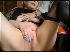 Smoking beauty strips and teases with masturbating Thumb