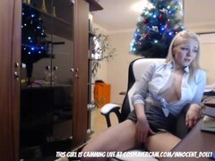 Dirty blonde secretary playing infront of the christmas Thumb